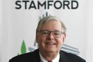 Stamford Mayor David Martin poses in his office at the Stamford Government Center in Stamford, Conn. Thursday, May 20, 2021.