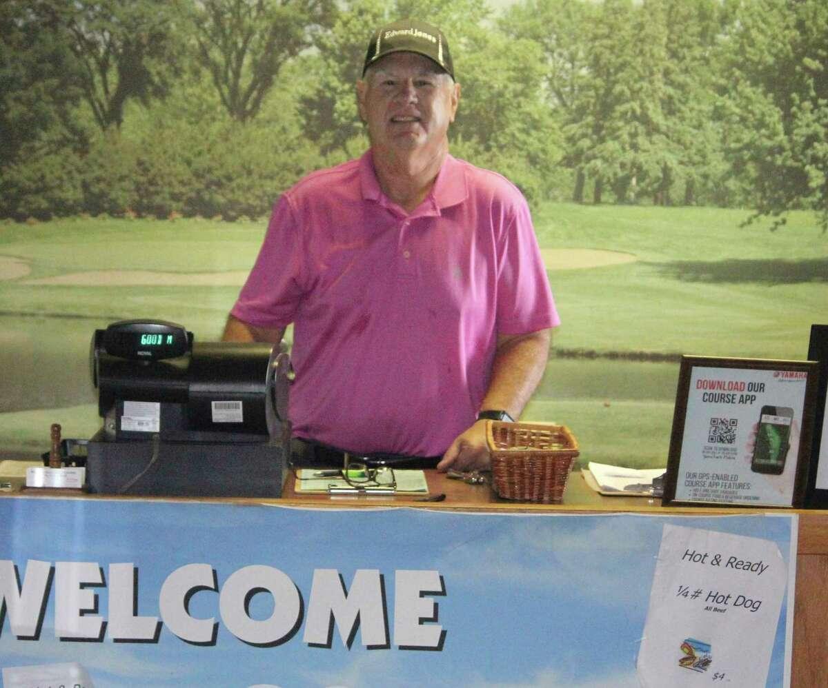 Spring Valley Golf Course secretary John Williams welcomes golfers during Tuesday league play. (Pioneer photo/John Raffel)