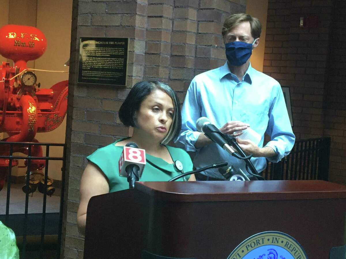 In this file photo, New Haven Health Director Maritza Bond, center, and Mayor Justin Elicker and other city officials, at a July 1 press conference.