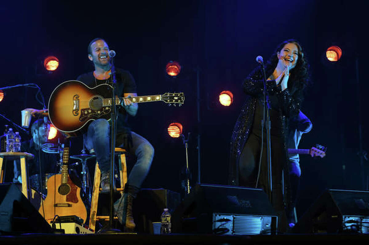 Kip Moore and Ashley McBryde perform at Ryman Auditorium in Nashville, Tennessee, in February.