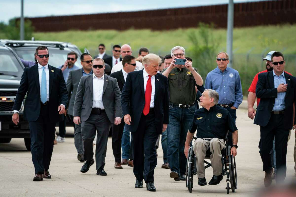 Former President Donald Trump and Texas Gov. Greg Abbott, R, arrive during a tour of the U.S.-Mexico border wall on June 30, 2021, in Pharr, Texas.