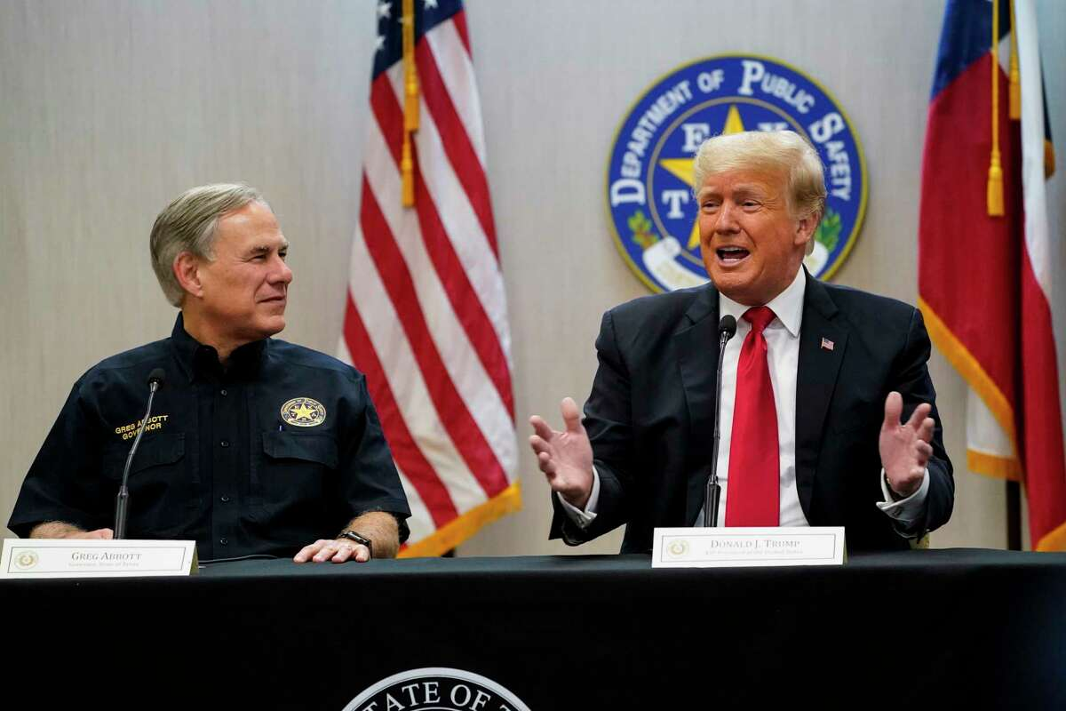 Texas Gov. Greg Abbott, R, and former President Donald Trump attend a security briefing with state officials before touring the U.S.-Mexico border wall on June 30, 2021, in Weslaco, Texas.
