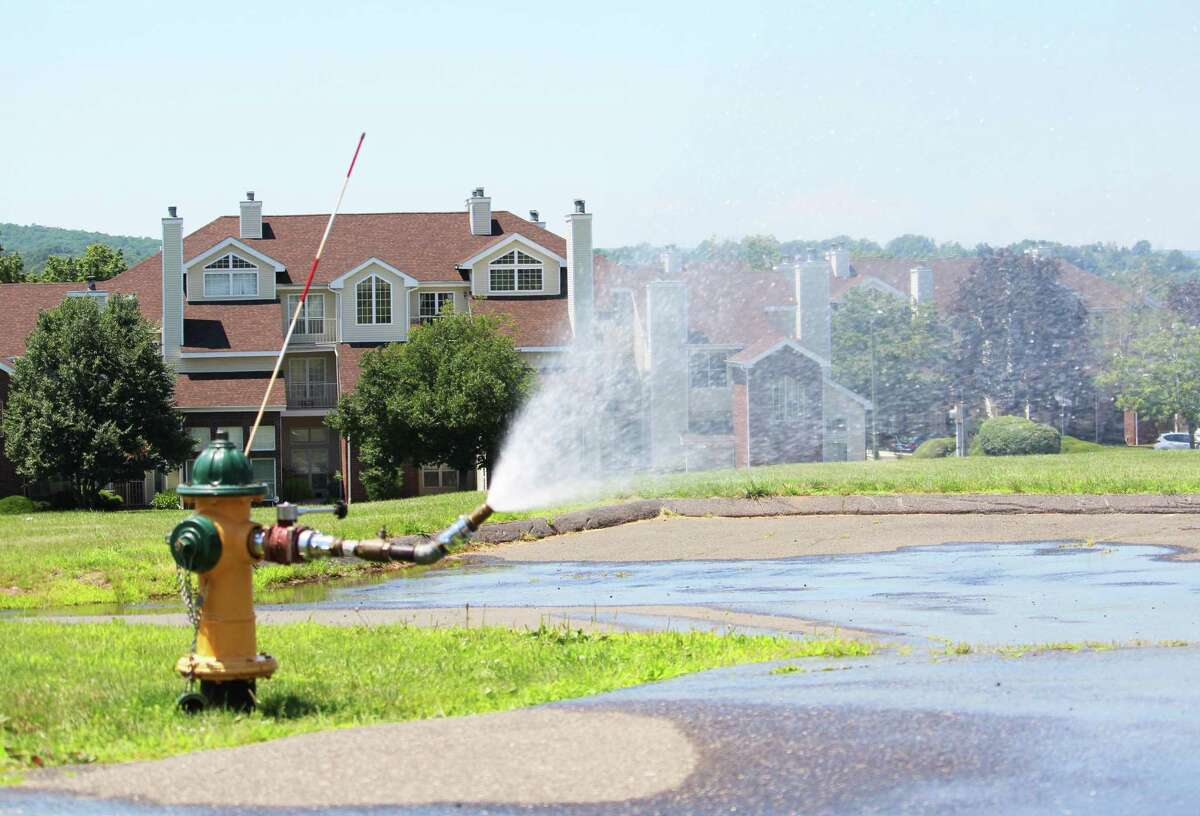 The Middletown Fire Department opened several fire hydrants at housing developments across the city this week to allow families to cool off during the heat wave. Shown here is the Highlands Crescent neighborhood.