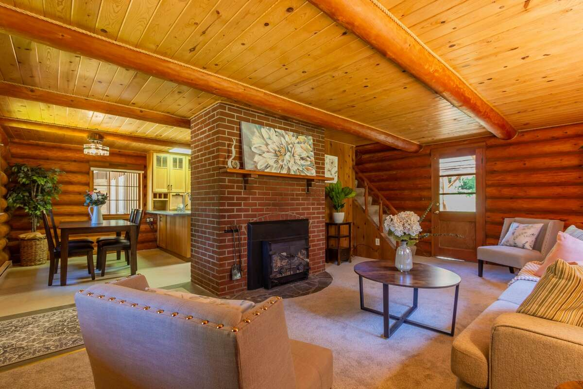 Inside, the home is cabin cozy, with the gleam of wood and warmth of two fireplaces.