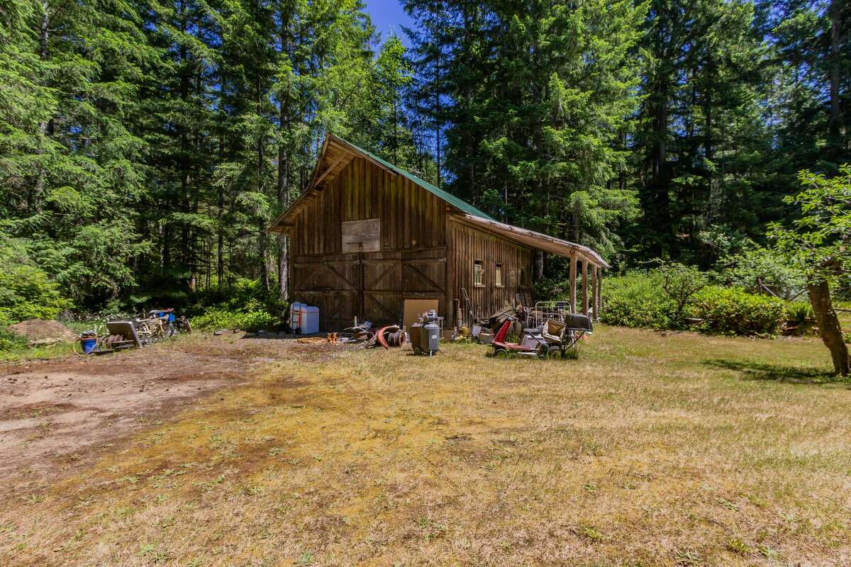 A large barn awaits you on this near 5-acre lot.