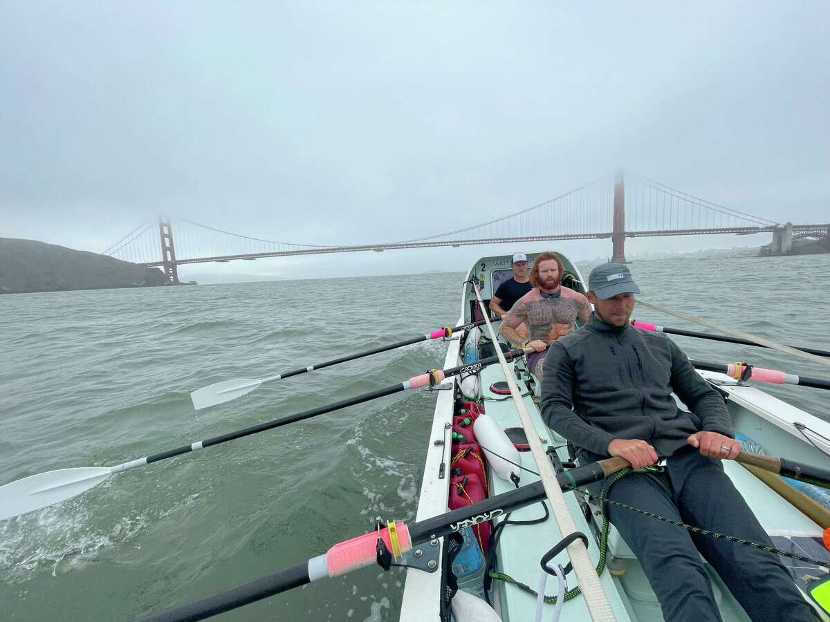 The Latitude 35 crew with Jason Caldwell (front) takes a training row in San Francisco Bay before a record Pacific crossing.
