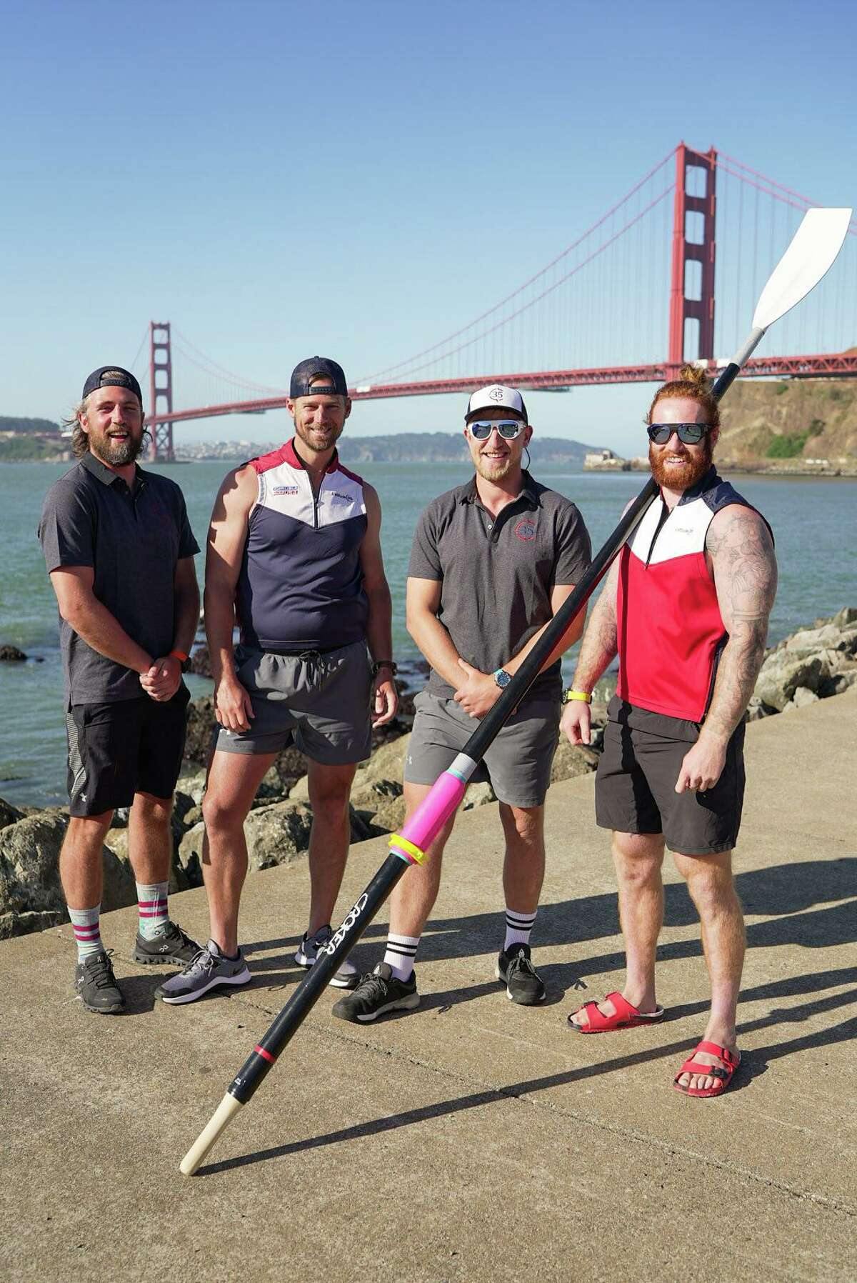 Jason Caldwell, second from the left, and the Latitude 35 crew before their bid to row to Hawaii.