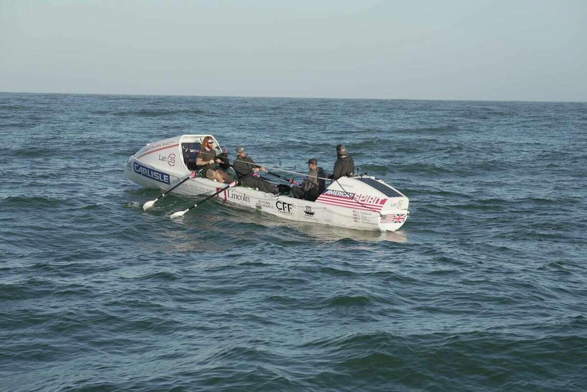 The Latitude 35 crew rows toward Hawaii.