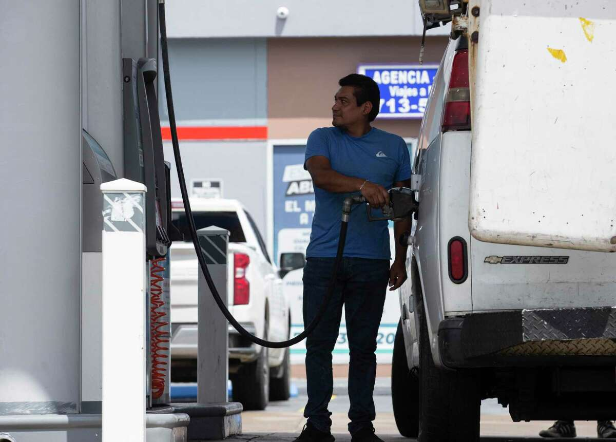 People pumping gas at a gas station Tuesday, May 25, 2021, in Houston.