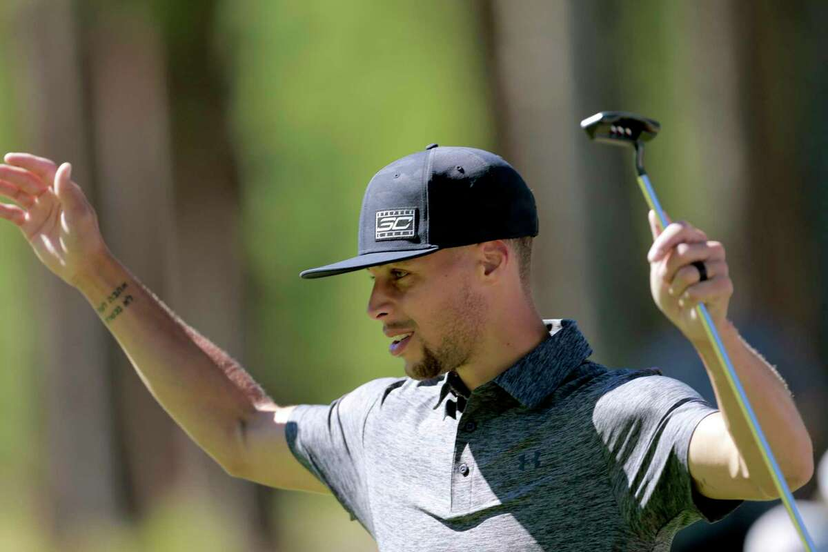 Golden State Warriors' Stephen Curry reacts to a fellow player's putt during the 2016 American Century Celebrity-Amateur Tournament in Lake Tahoe, Nevada, California, on Thurs. July 22, 2016.