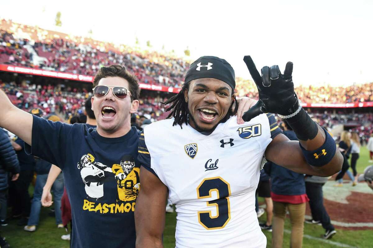 PALO ALTO, CA - NOVEMBER 23: California Golden Bears cornerback Elijah Hicks (3) celebrates with a supporter after the college football game between the California Golden Bears and the Stanford Cardinal at Stanford Stadium on November 23, 2019 in Palo Alto, CA. (Photo by Cody Glenn/Icon Sportswire via Getty Images)