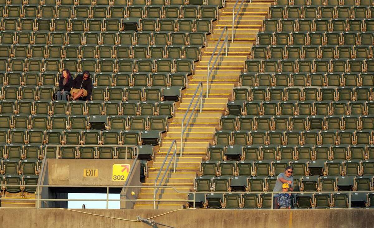 Fans are able to sit where they please now that the games allow full capacity as the Oakland Athletics played the Texas Rangers at the Coliseum in Oakland, Calif., on Tuesday, June 29, 2021.