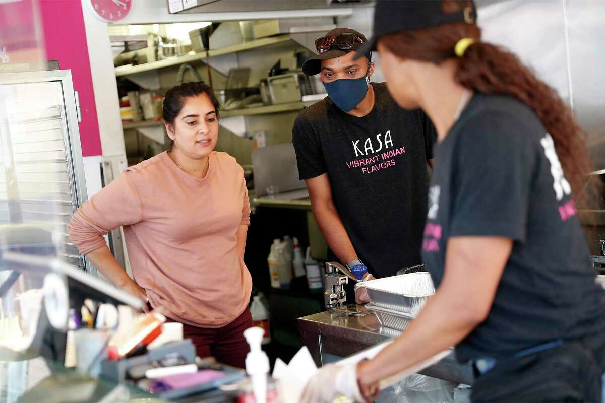 Kasa Indian Eatery owner Anamika Khanna (left) confers with Ibrahim Hornesby and his sister, Zaynab Hornesby (right) at the restaurant's Polk Street location in San Francisco.