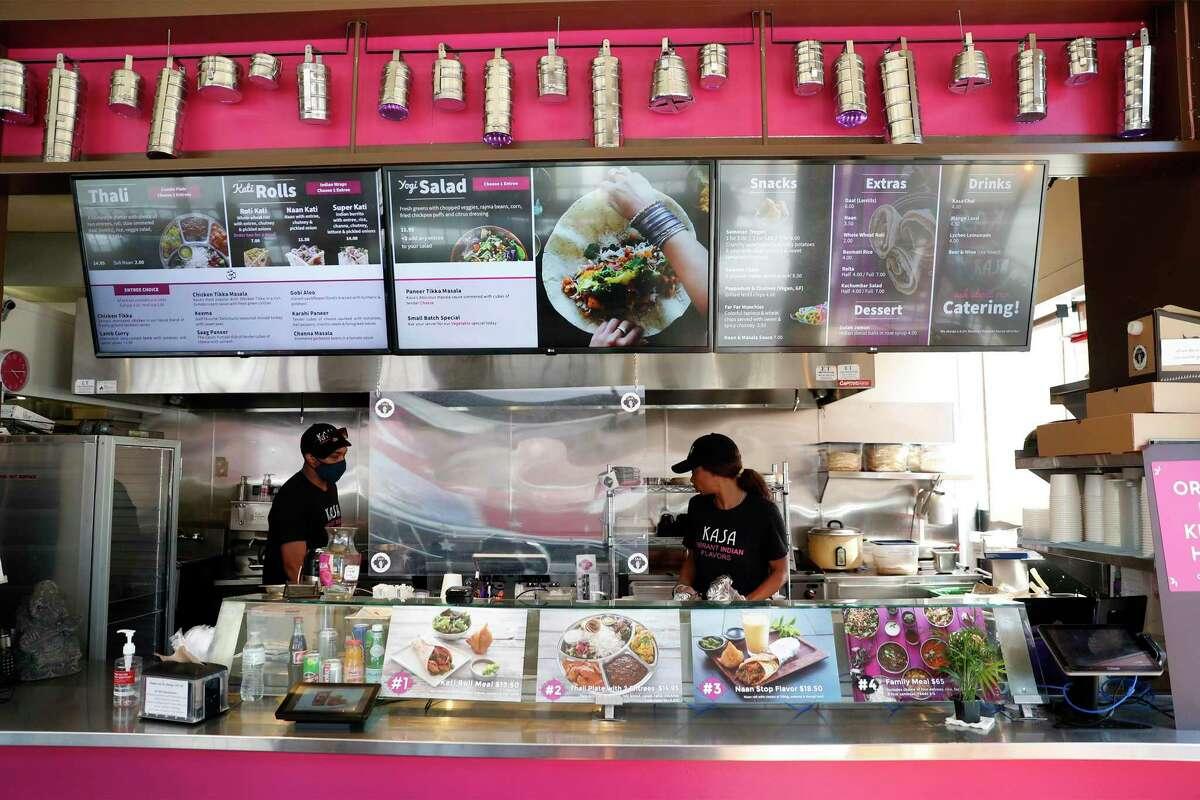 Ibrahim Hornesby (left) and Zaynab Hornesby work at Kasa Indian Eatery on Polk Street in San Francisco.