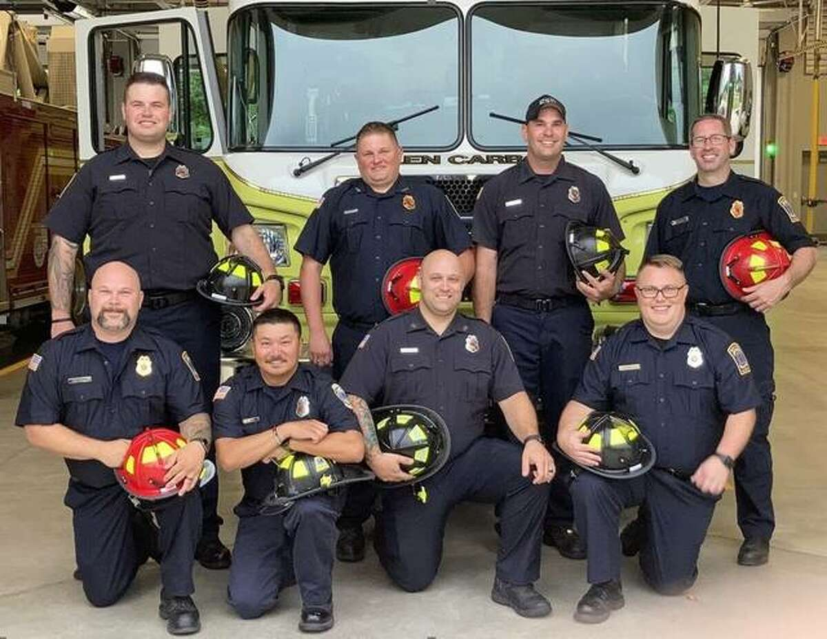 Recognition of training completions and appointments to Officer and Firefighter status were made at the Glen Carbon Fire Protection District's June 29 meeting. From left are, front row, Captain Alex Campbell, FF/Paramedic Nathan Wahl, FF/Paramedic Chad VanRyn and FF/Paramedic James Schulte; back row, FF/Paramedic Camron Overholtz, Lieutenant Jason Reaka, FF/Paramedic Zack Napoli and Lt. Kiko Perez.