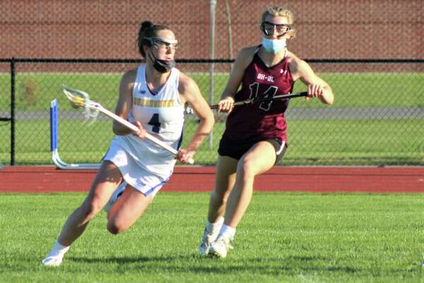 Queensbury's Brigid Duffy, left, is the Times Union girls' lacrosse athlete of the year.
