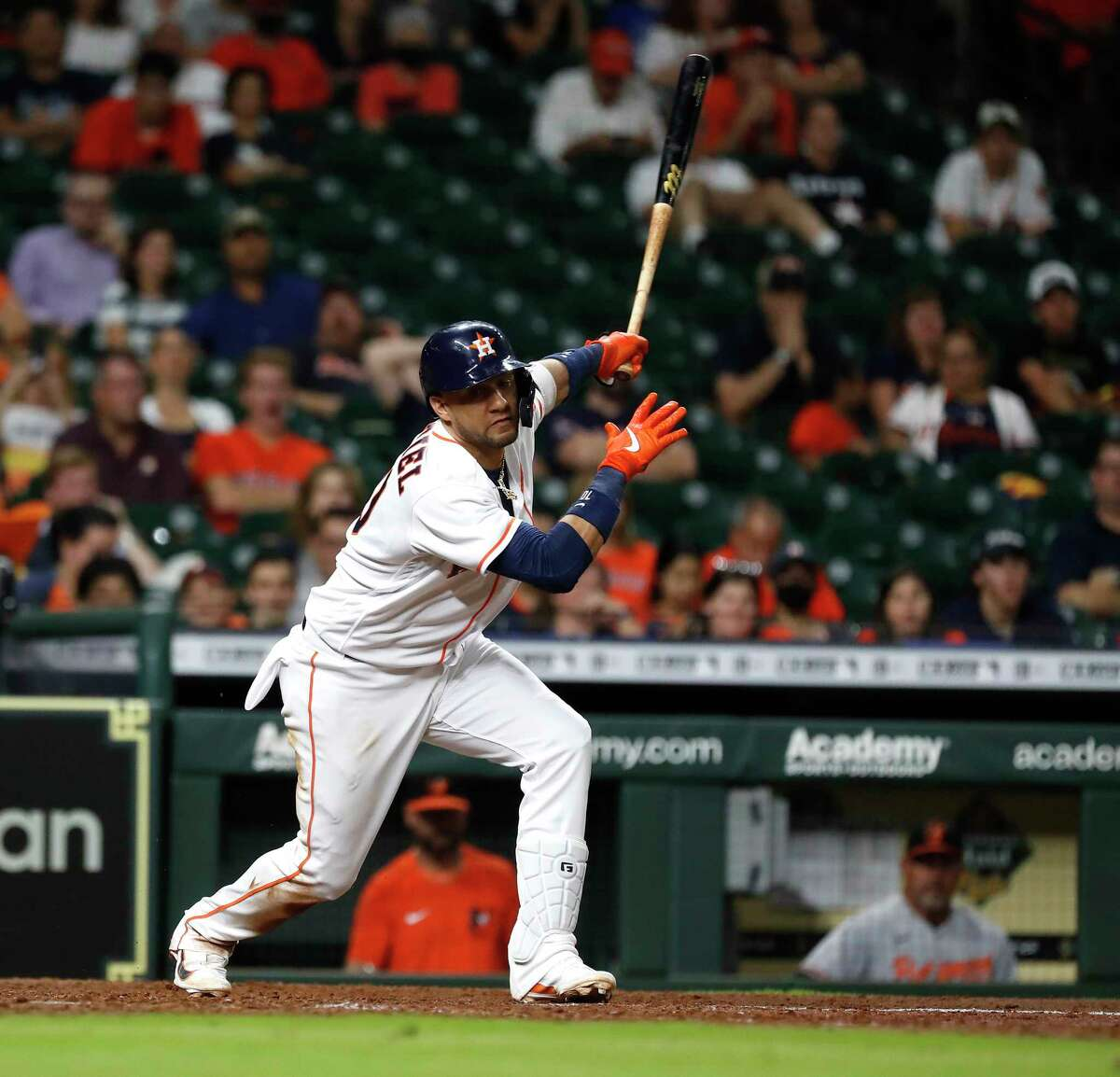 Houston Astros Yuli Gurriel (10) strikes out against Baltimore Orioles relief pitcher Cole Sulser (54) during the eighth inning of an MLB baseball game at Minute Maid Park, Wednesday, June 30, 2021, in Houston.