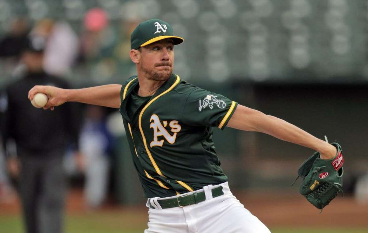 Chris Bassitt (40) pitches for Oakland as the Oakland Athletics played the Texas Rangers at the Coliseum in Oakland, Calif., on Wednesday, June 30, 2021.