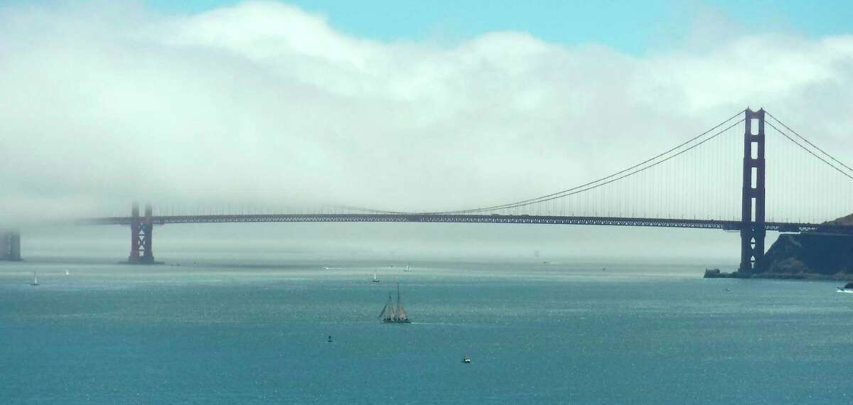 The Golden Gate Bridge, partially hidden in fog - you can get close by taking a boat ride on the bay.