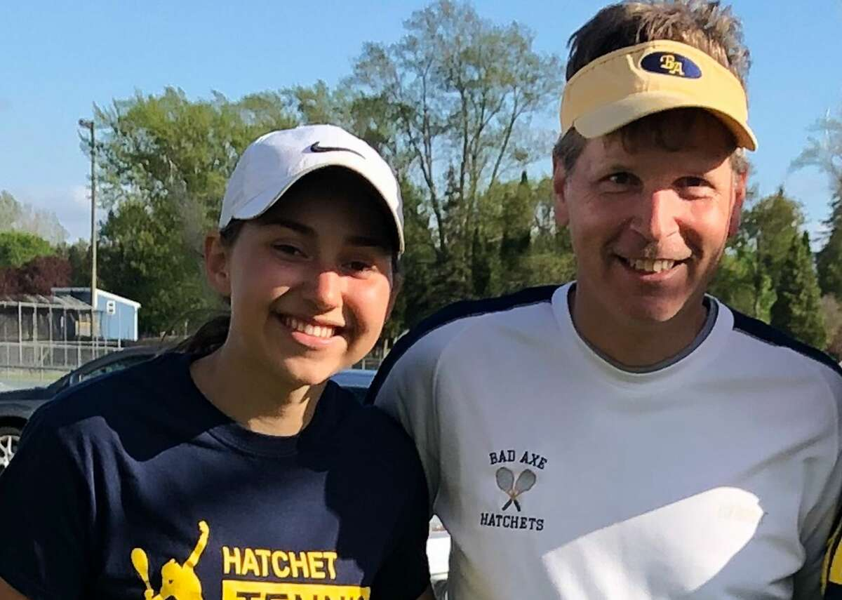Bad Axe Class of 2021 valedictorian Katey Krohn poses with her tennis coach, Mark Prescott, who died June 23 in a cycling accident.