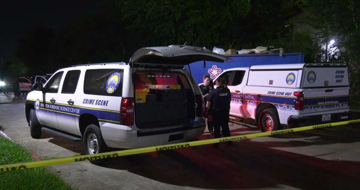 Officials investigate a triple homicide Wednesday night at a Houston apartment. The suspect remains at large.