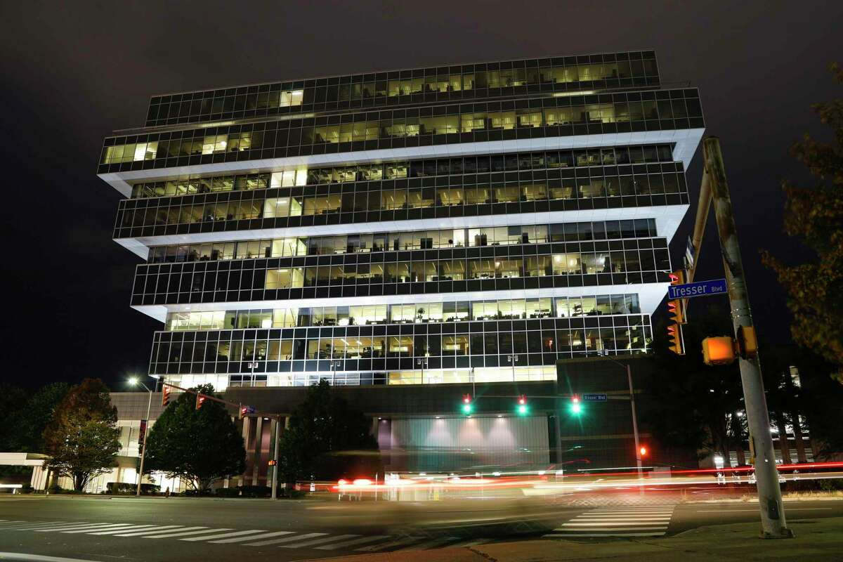 Cars pass Purdue Pharma headquarters at night in Stamford, Conn., in 2019.