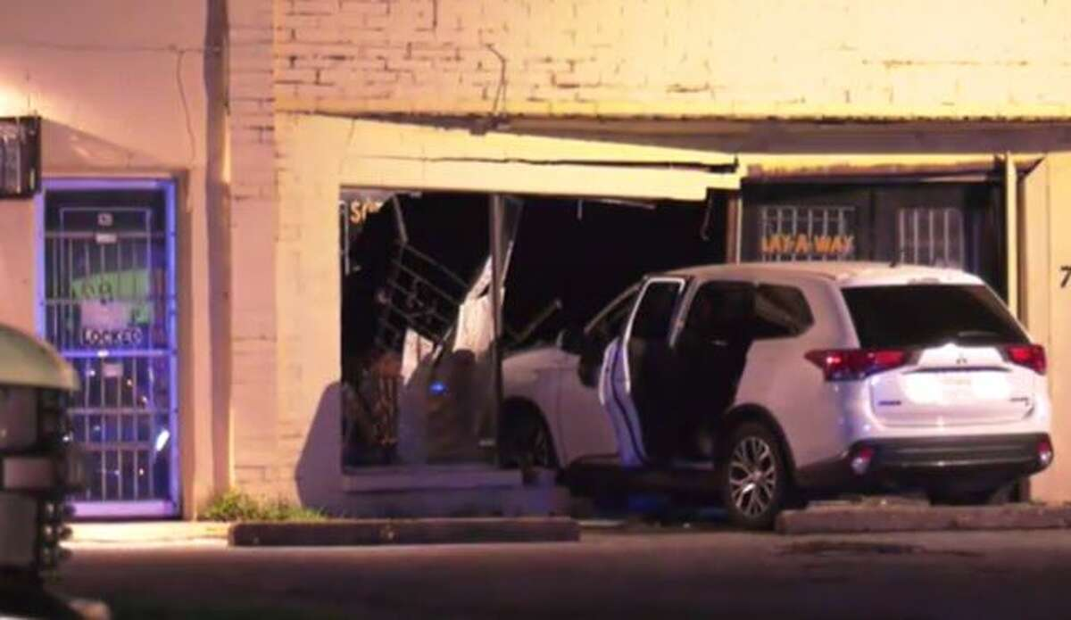 A driver crashed into a storefront and died after he was shot on Cullen Boulevard in Houston, police said.