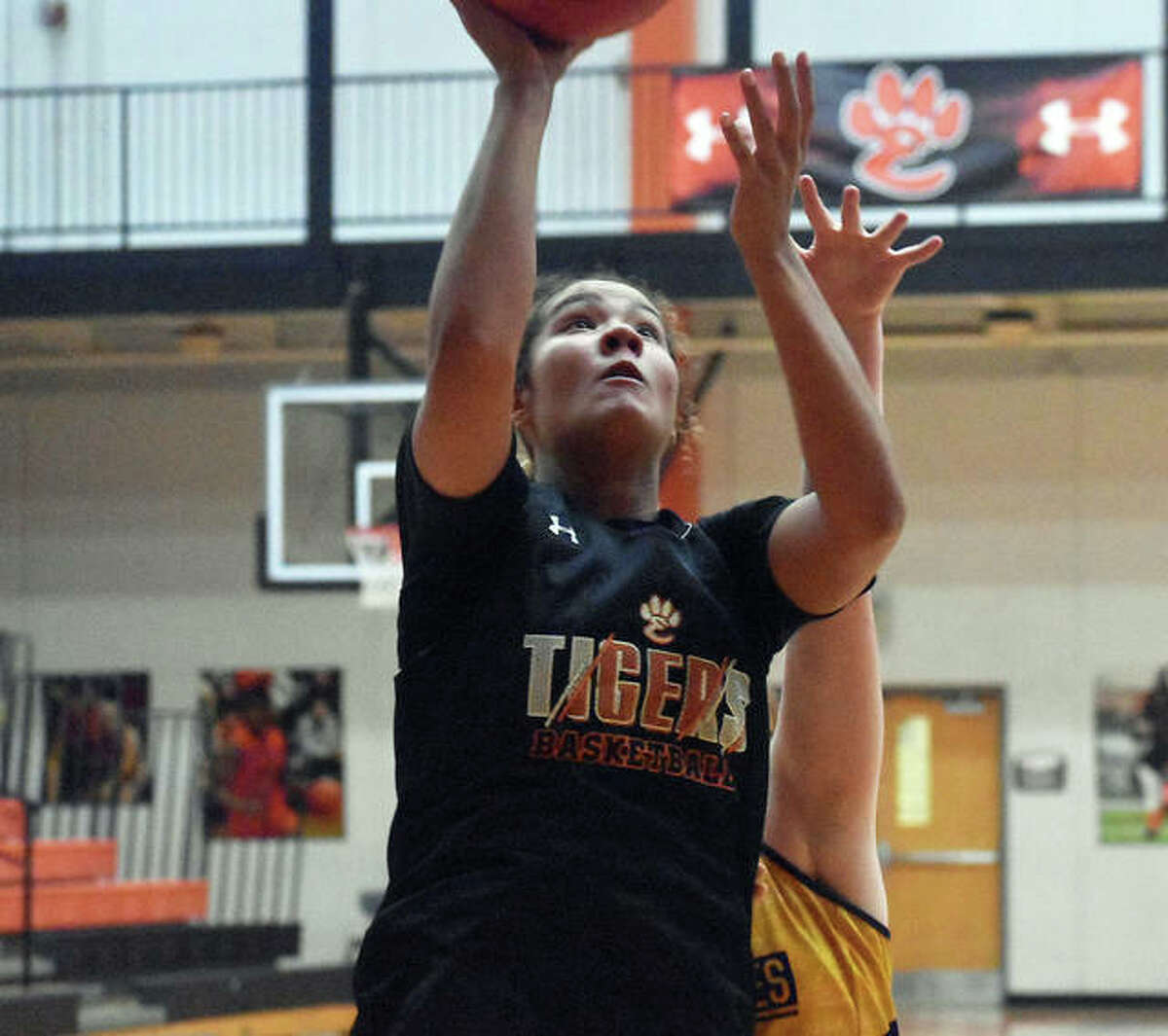 Edwardsville senior guard Sydney Harris scores from underneath the basket against Civic Memorial on Tuesday in Edwardsville.