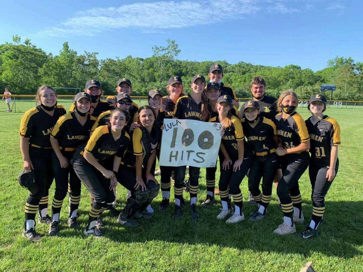 Maddie Lula celebrates reaching the 100-hit milestone with her Law teammates after defeating East Haven in the SCC quarterfinals.