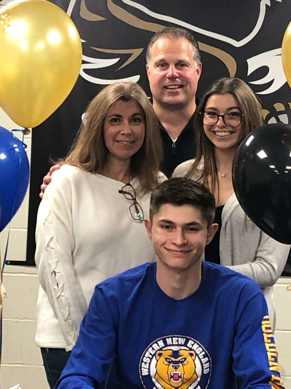 Johnny Bova is surrounded by mom Alice, dad John and sister Gabby when he signed a letter of intent to play baseball at Western New England University.