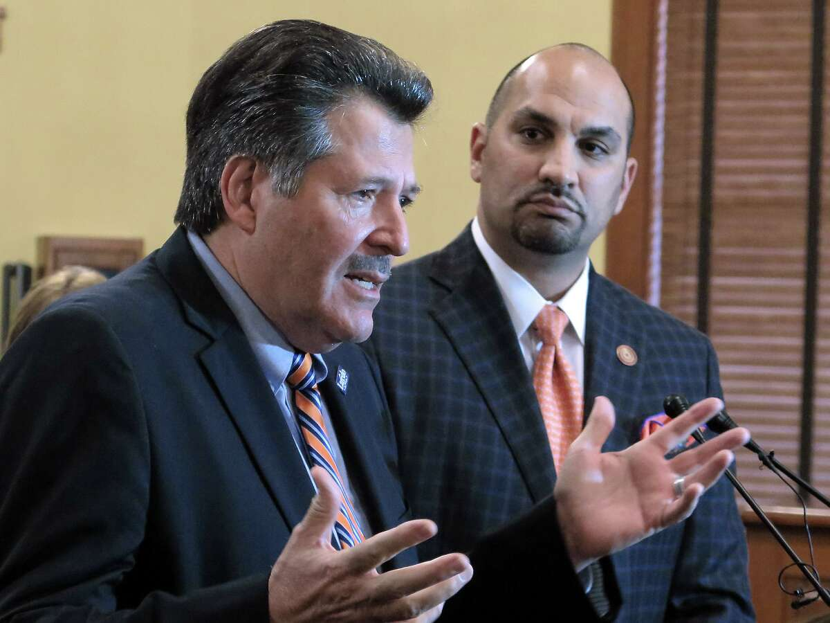 Mayor Pete Saenz and Webb County Judge Tano Tijerina are pictured in 2017 at the Webb County Commissioners Court. Each expressed the desire to join Gov. Greg Abbott's list of counties declaring a disaster regarding the border this week.