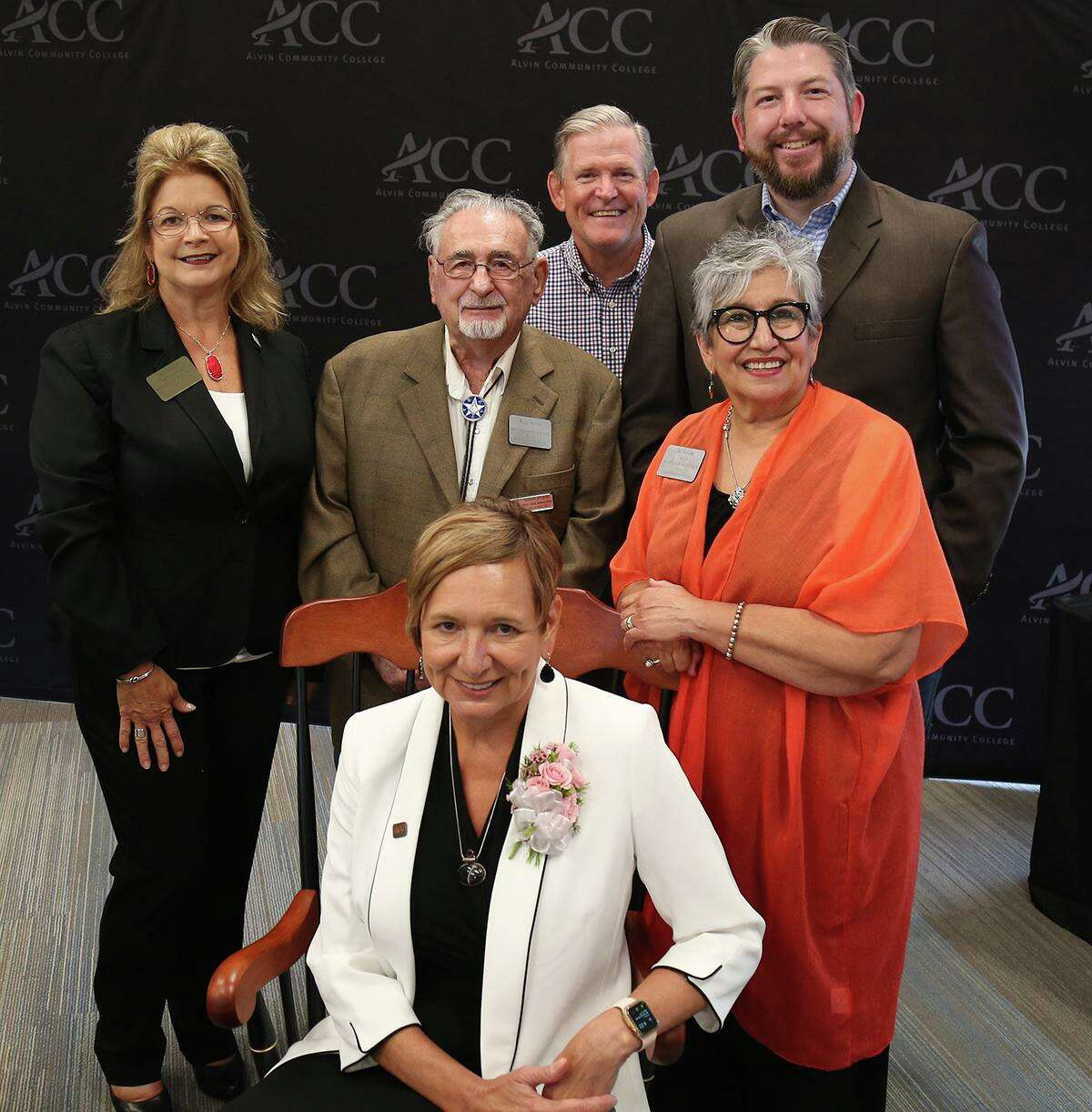 Alvin Community College regents honor retiring President Emeritus Christal M. Albrecht, seated, during a June 24 reception. Behind her are board vice chair Jody Droege, left, regents Roger Stuksa, Jim Crumm and Jake Starkey and board chair 'Bel Sanchez.
