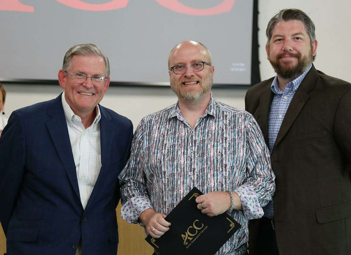 Alvin Community College regents Jim Crumm, left, and Jake Starkey, right, recognize interim Distance Education Director Pat Sanger June 24 for his department's efforts during the COVID-19 pandemic.