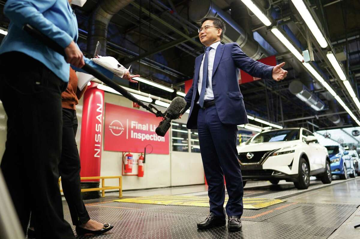 Envision Group Chief Executive Officer Lei Zhang speaks inside the Nissan plant in Sunderland, U.K., on July 1
