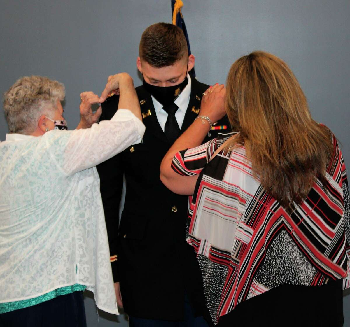 Michael Alderman, (center) a graduate of Ferris State University's Mechanical Engineering Technology program from Westland, received his commission as a Second Lieutenant in the United States Army on Monday, May 3, at a ceremony on campus in Big Rapids. (Courtesy photo)