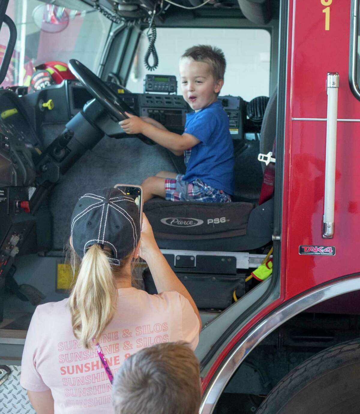 Kristine Manera takes a picture of her son Klay during the open house 07/01/2021 during the ceremony to officially open the new Station 5 fire house on the corner of Garfield and W. Golf Course Rd.. Tim Fischer/Reporter-Telegram