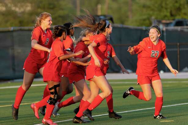 The Woodlands defender Rylie Graves (27) and her teammates after after they score a goal during the second half of a Region II-6A quarterfinals soccer match against Tomball at Woodforest Bank Stadium, Friday, April 2, 2021, in The Woodlands.