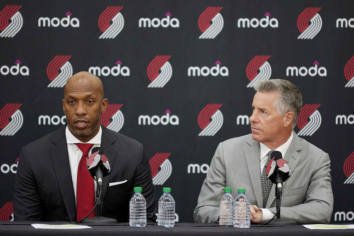 Neil Olshey, right, and Chauncey Billups talk to the media after Billups was announced as the head coach of the Portland Trail Blazers at the team's practice facility in Tualatin, Ore., Tuesday, June 29, 2021.