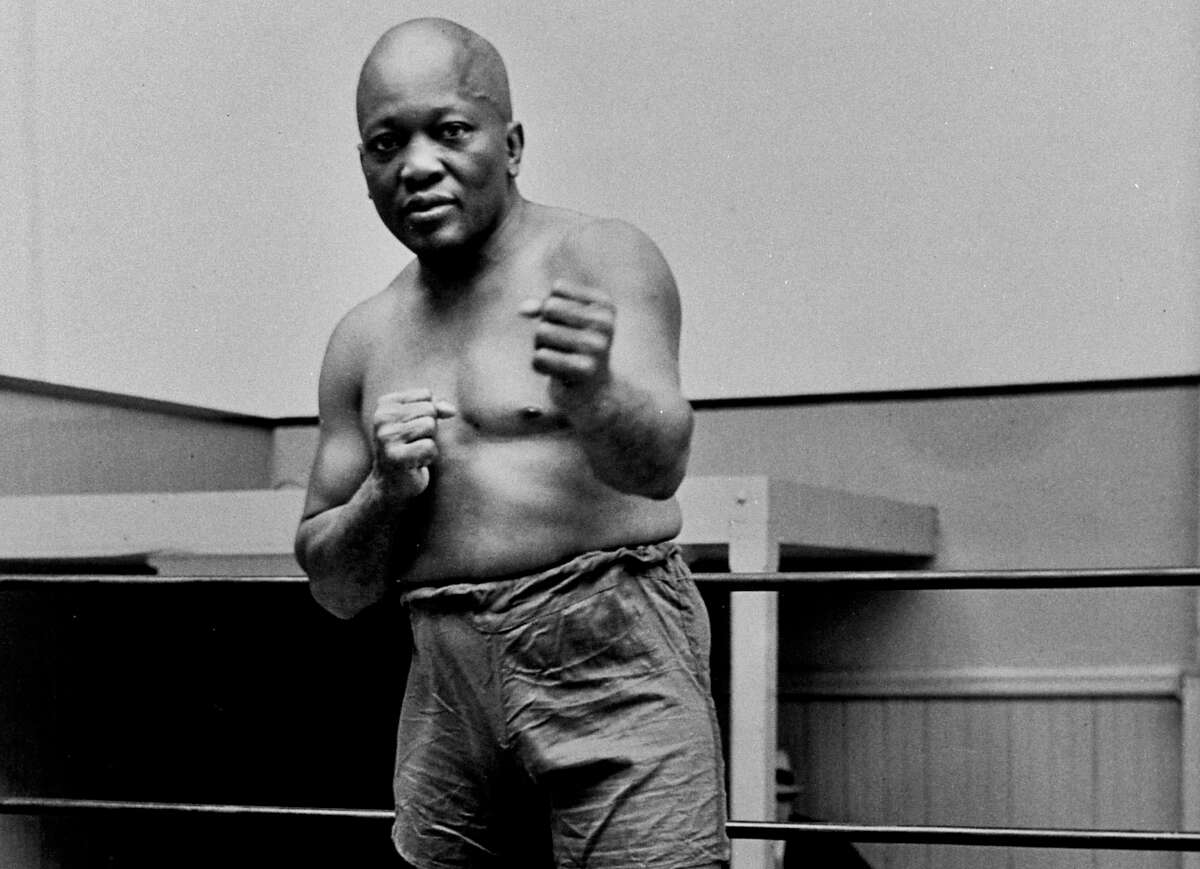 In this 1932 photo, boxer Jack Johnson, the first black world heavyweight champion, poses in New York City.