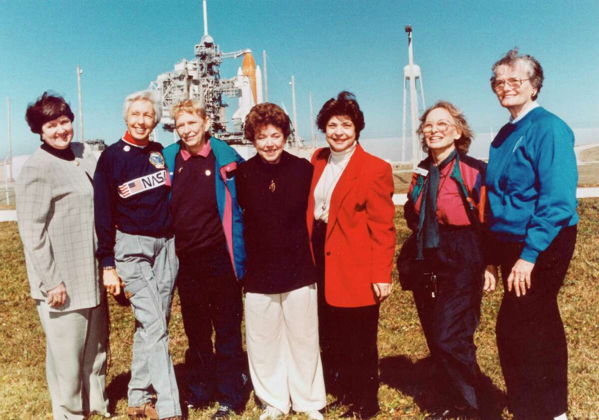 """FILE - In this 1995 file photo, members of the FLATs, also known as the Mercury 13, gather for a photo as they attend a shuttle launch in Florida. From left are Gene Nora Jessen, Wally Funk, Jerrie Cobb, Jerri Truhill, Sarah Rutley, Myrtle Cagle and Bernice Steadman. Blue Origin's Jeff Bezos has chosen Funk, an early female aerospace pioneer, to rocket into space with him later this month. The company announced Thursday, July 1, 2021, that Funk will be aboard the July 20 launch from West Texas, flying as an """"honored guest."""" Funk, along with the other women of Mercury 13, went through astronaut training in the 1960s, but never made it to space - or even NASA's astronaut corps - because of their gender. (NASA via AP)"""