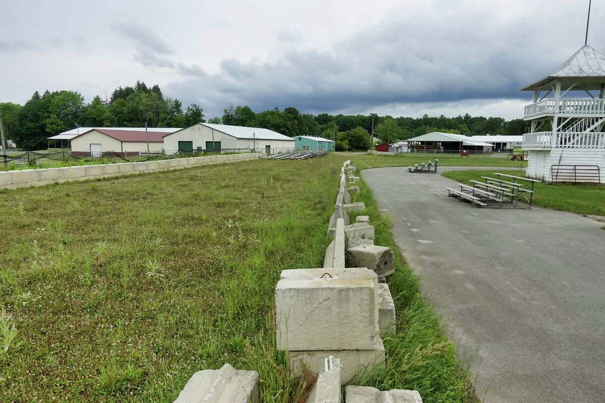 A view of the area where the grandstands once stood at the Saratoga County Fairgrounds on Thursday, July 1, 2021, in Ballston Spa, N.Y. The judging stand still remains. The grandstand had to be demolished due to safety issues. (Paul Buckowski/Times Union)