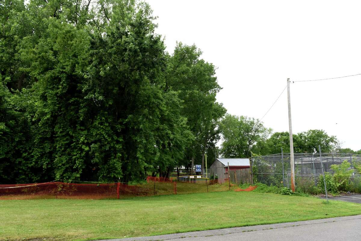 An area of land behind a baseball field at Woodlawn Park is cordoned off after possible asbestos from construction waste was discovered on Thursday, July 1, 2021, in Albany, N.Y. (Will Waldron/Times Union)