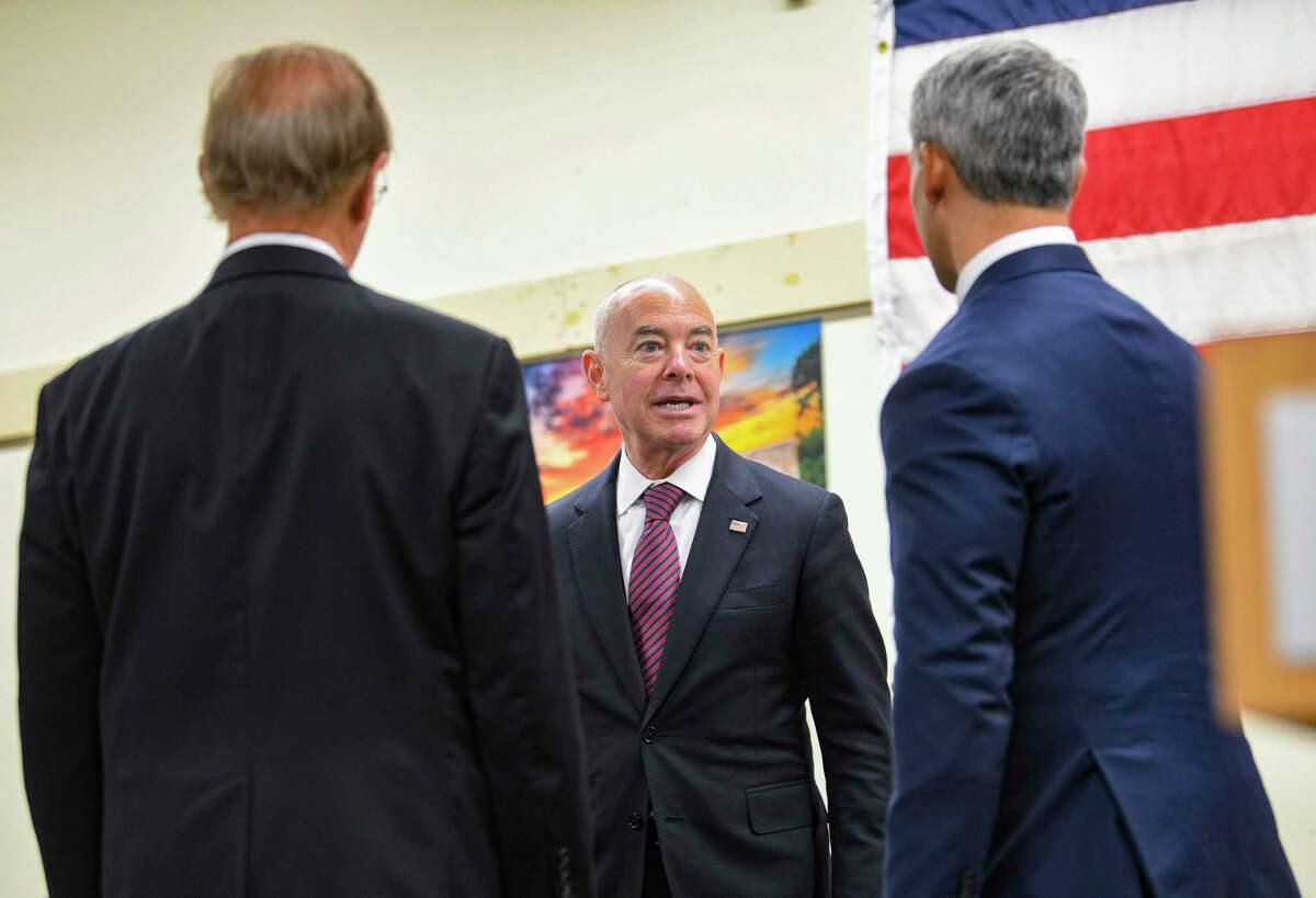 Homeland Security Secretary Alejandro N. Mayorkas, center, praises County Judge Nelson Wolff, left, and Mayor Ron Nirenberg during a tour at the Wonderland of the Americas COVID-19 vaccination hub on Tuesday..