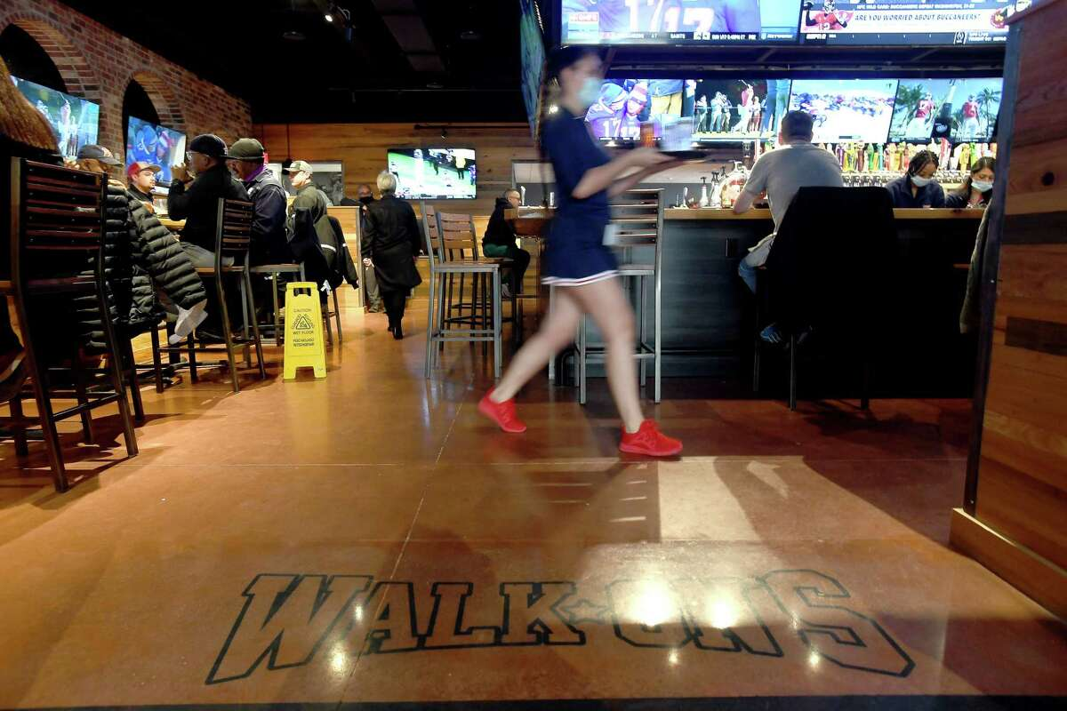 Diners enjoy their first taste of Walk-On's Sports Bistreaux on its opening day in Port Arthur in January.