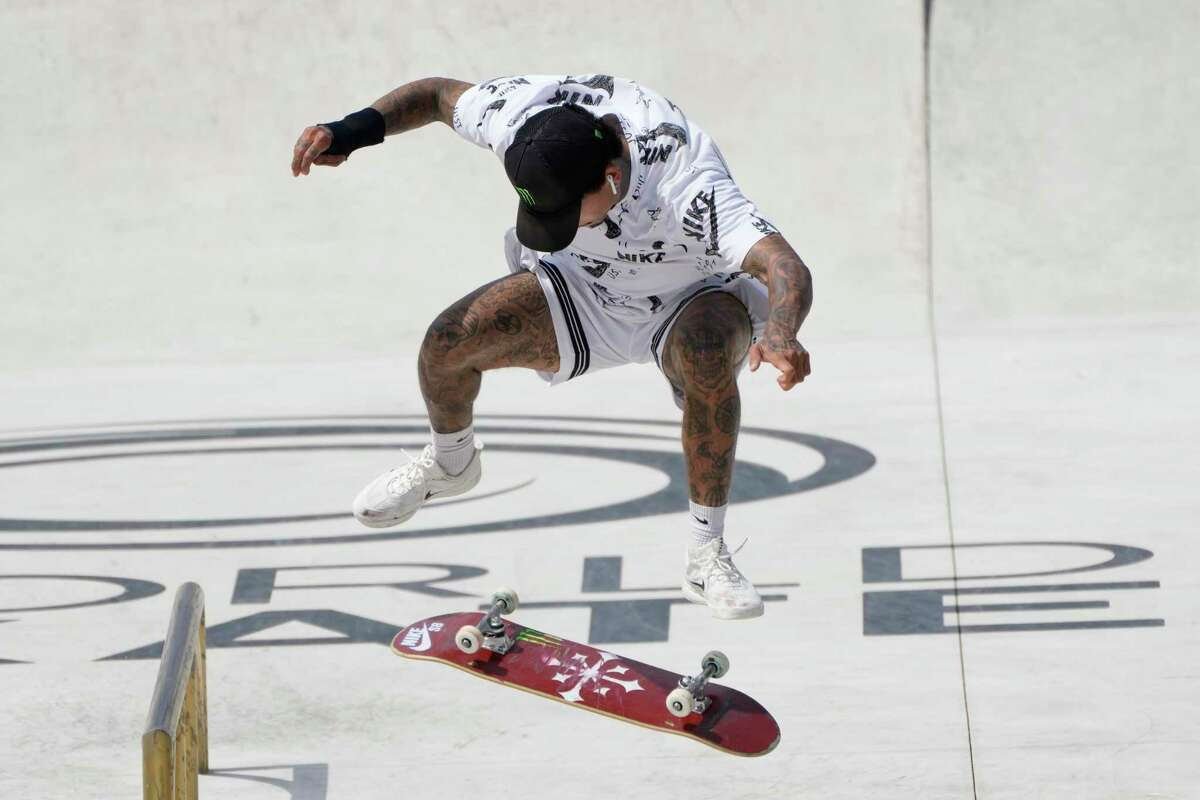 FILE - In this June 6, 2021, file photo, Nyjah Huston, of the United States, competes in a Street Skateboarding World Championships final, a qualifying event for Tokyo Olympic Games, in Rome. Skating is one of four debut Olympic sports, along with karate, surfing and sport climbing.