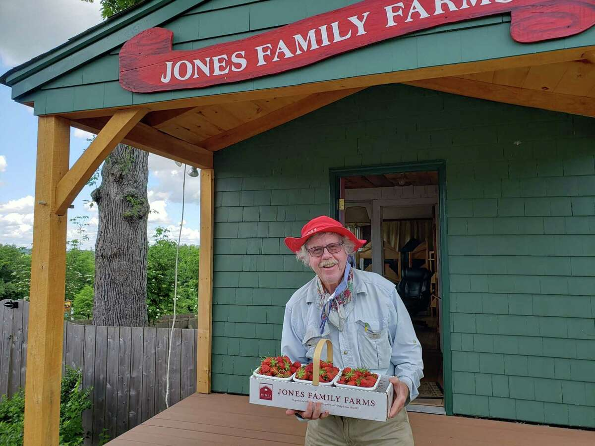 Fifth generation farmer Terry Jones with just-picked berries at Jones Family Farm in Shelton.