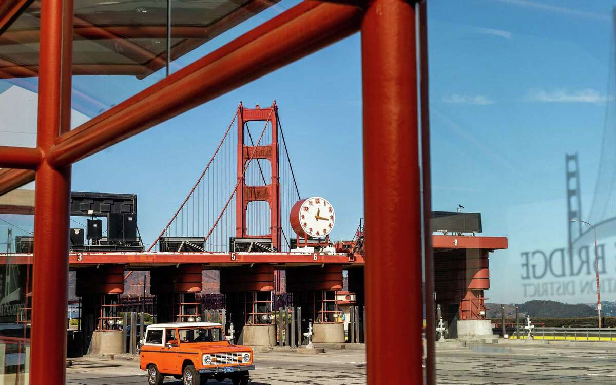 A car passes the Golden Gate Bridge toll plaza in San Francisco. Tolls rose again for bridge crossings, in keeping with the bridge district's scheduled rate increases, meant to keep pace with rising maintenance costs.