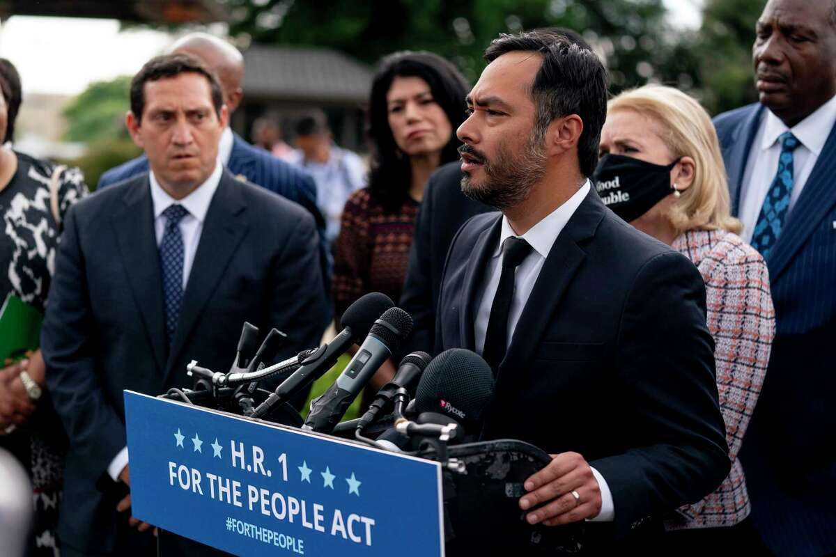 Rep. Joaquin Castro, D-Texas, accompanied by Texas Rep. Trey Martinez Fischer of San Antonio, left, and other Democratic Texas lawmakers, speaks at a news conference on a voting rights bill on Capitol Hill in Washington, Tuesday, June 15, 2021. (AP Photo/Andrew Harnik)