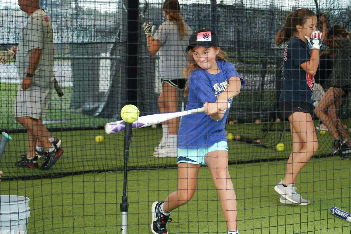 Brynlea Sledge participates in a batting drill Wednesday at the Bay Area Christian summer softball camp.