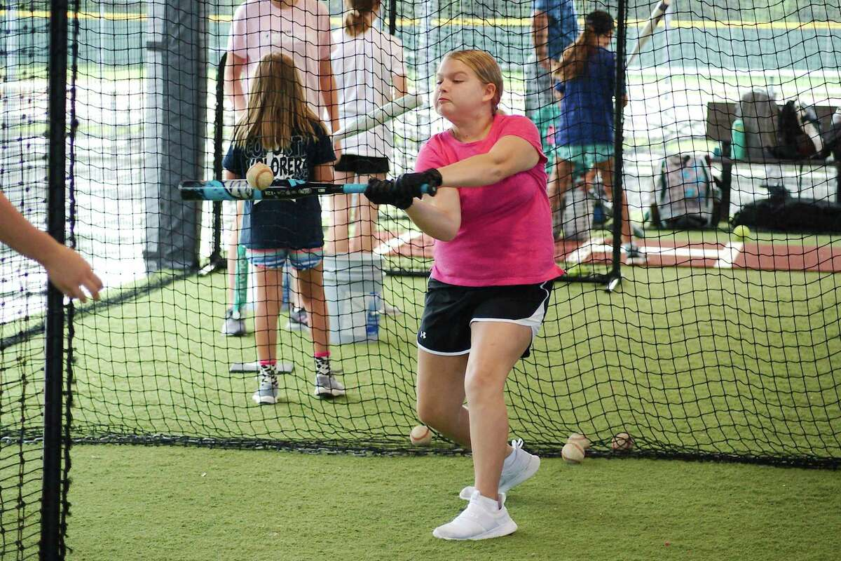 Addison Grossman participates in a batting drill Wednesday at the Bay Area Christian summer softball camp.
